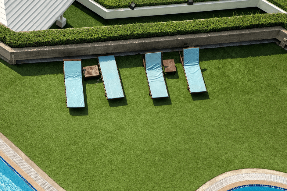 pool side with artificial grass