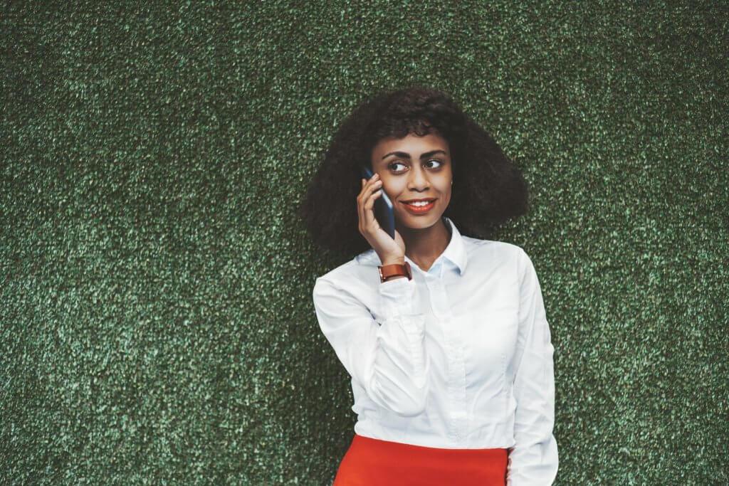 black woman wearing semi formal in artificial grass